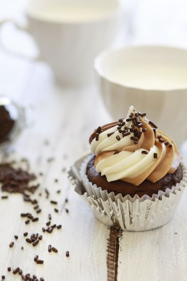 nutella cupcake with triple swirled frosting - cream cheese, nutella cream cheese, and almond butter cream cheese frosting