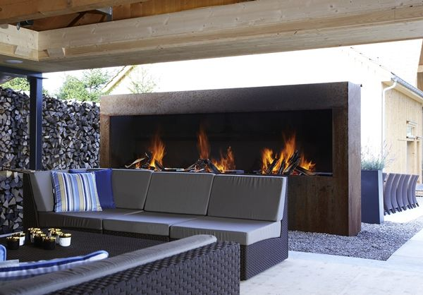 Outdoor fireplace with an area to relax and entertain... amazing.