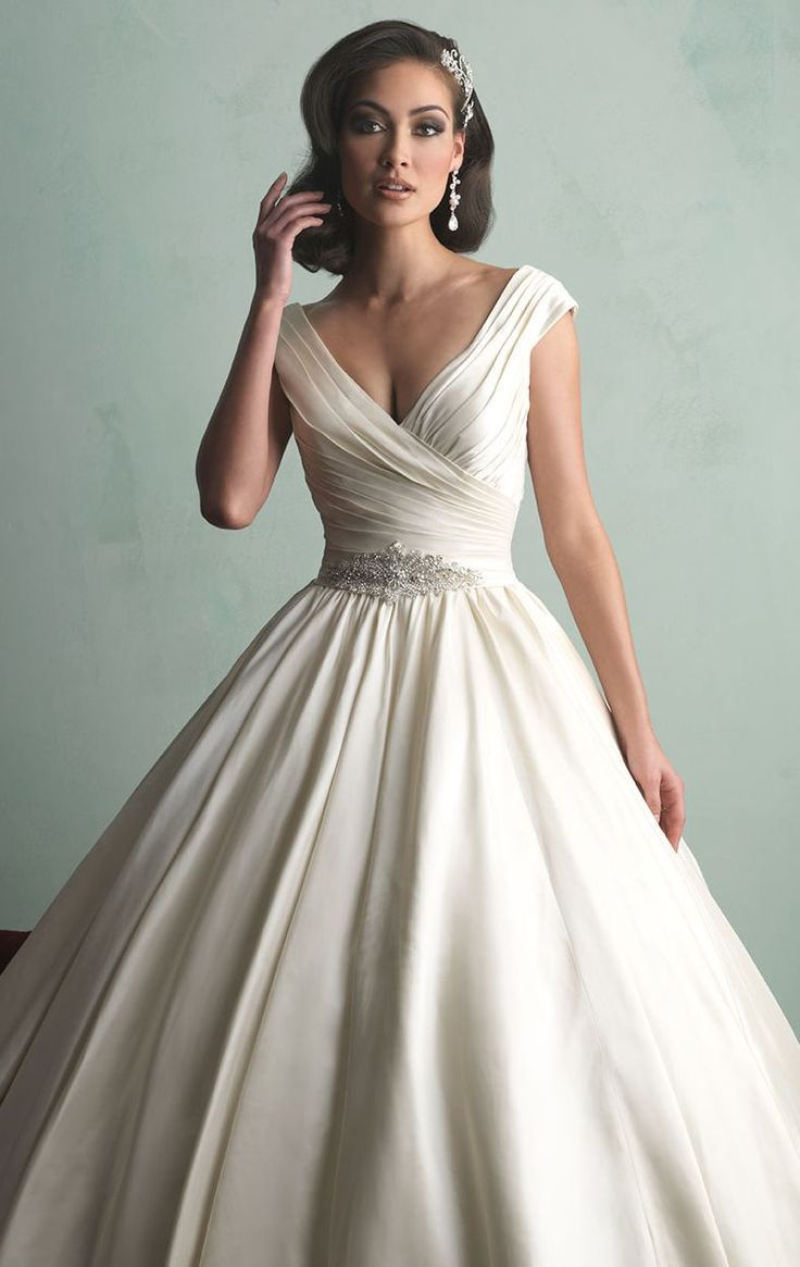 You will be an elegant princess on your day in Allure Bridals 9155. This wedding gown features plunging V-neckline nad cap sleeves. The pleated bodice is embellished with beaded band. A ballgown skirt will make you look congenial.
