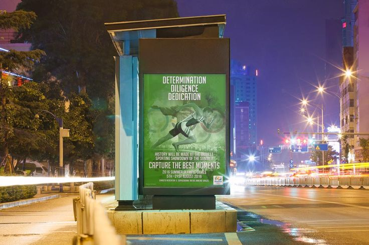 RIO 2016 - Bus stop advert for the 2016 Summer Olympics in the green version giving out the slogans for the running athlete for determination, diligence and dedication.