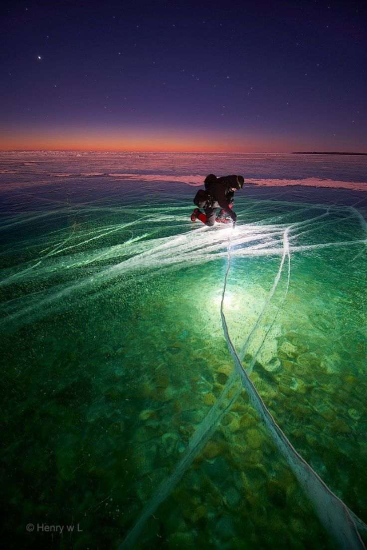"""""""Man with Flashlight on Ice creates Beauty"""" The 100 best photographs ever taken without photoshop"""
