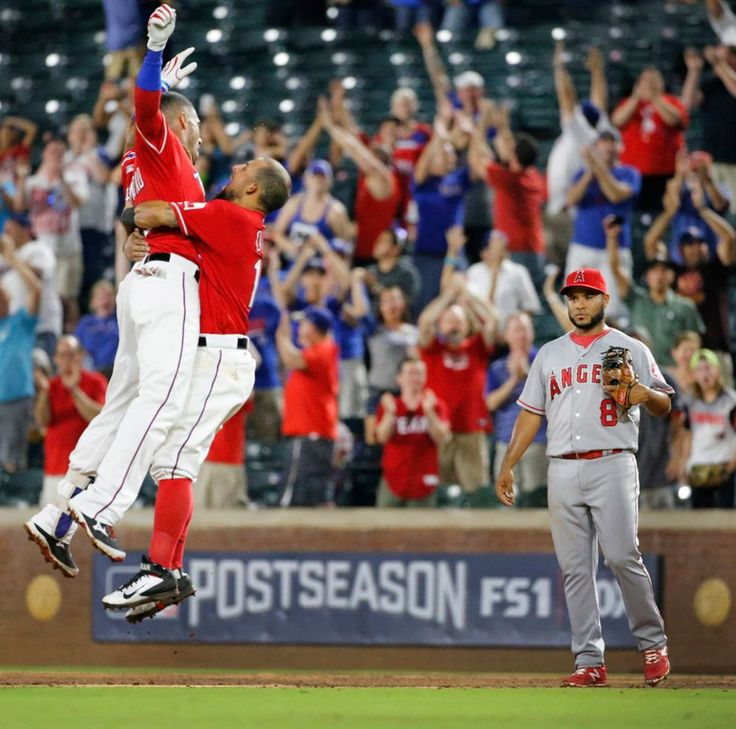Ian Desmond gets a leaping hug from Rougned Odor  after Desmond's ninth-inning single at Globe Life Park on Monday, September 19, 2016. (Louis DeLuca/The Dallas Morning News)