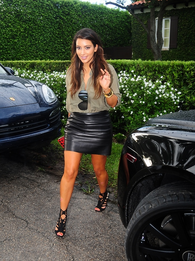 Isabel Marant top, Celine skirt, Jimmy Choo booties, Louis Vuitton cuff and
