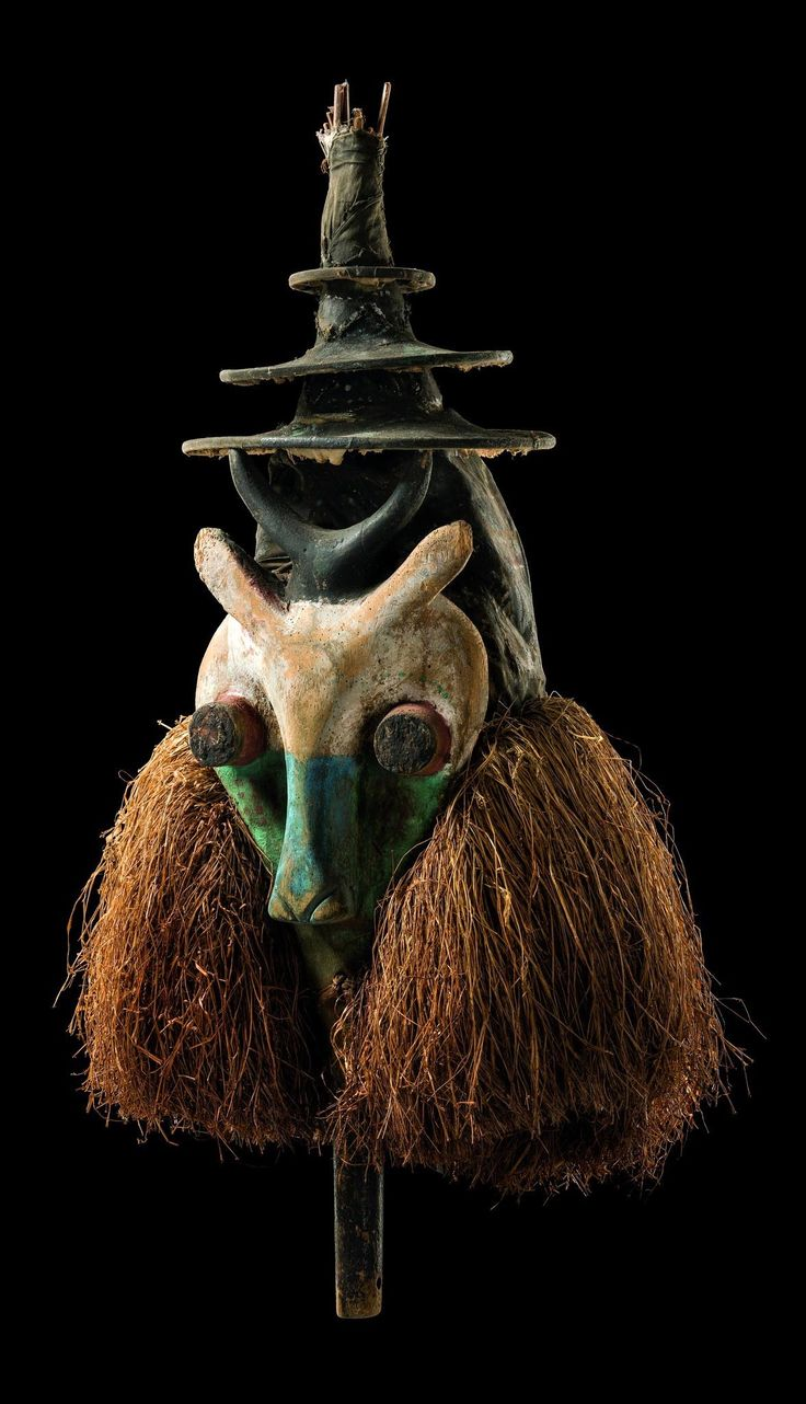 Africa | Mask from the Yaka people of DR Congo | Wood, polychrome paint, rattan bonnet, grass fiber cuff