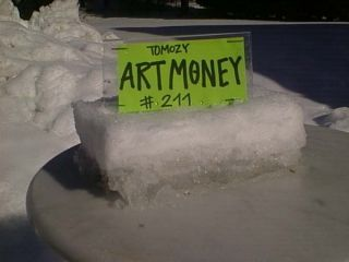 This spectacular artmoney is made of snow!!  It was made for the exhibition in Øksnehallen, in Copenhagen 2005. -And naturelly shown in a freezer...  Produced by Frank Tomozy, Demark.