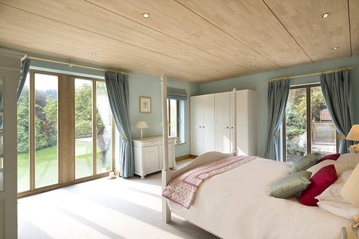 A simple but elegant bedroom design featuring Signature's slim profile wood casement windows combined with wood double french doors.