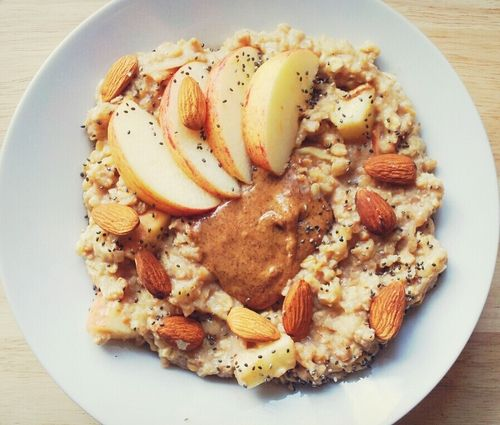 goalstopursue:   Oatmeal made with organic soy milk, apples, cinnamon and ground flax seeds topped with almond butter, apple slices, almonds and chia seeds