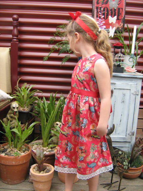 Red Australiana dress size 5 Fabric has kangaroos koalas dingos lizards platypus on it