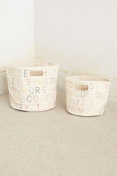 These aren't exactly the same baskets i found, but close! Alphabet Canvas Basket - anthropologie.com - laundry basket idea for Erik's room
