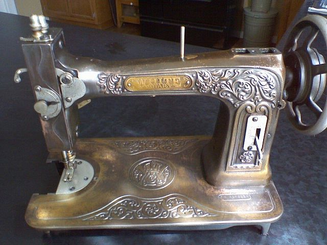 White bronze embossed rotary sewing machine