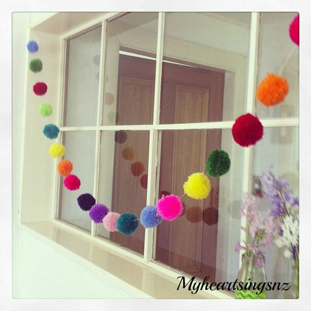 Instant cheerfulness! Multi coloured pompom garland