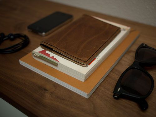 Another leather passport cover tutorial.  This is hand-sewn through holes poked with an awl.