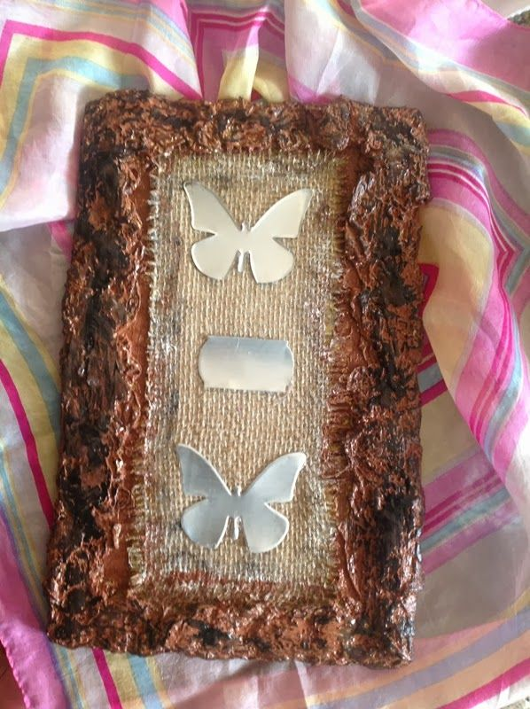 sizzix die for butterflies...burlap...and toilet paper...on wood
