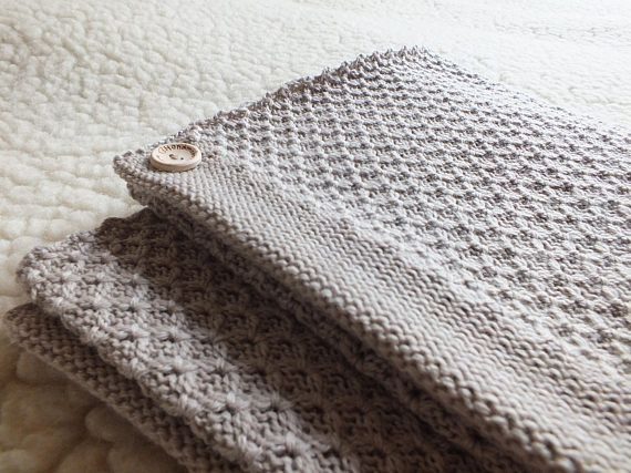 Lovely, natural and soft machine knitted, hand finished baby blanket. It will keep your baby warm and comfortable. Color: light beige Made from 100 % merino wool. It has different texture on the other side. Care instructions: Hand wash in warm 30 º C water. Blanket size: 90 cm x 70 cm Weight approximate 300g • Merino wool is highly breathable. This helps to regulate the body temperature, keeping you warm in cold weather and protects from overheating when it is warm. • Extra fine, soft Mer...
