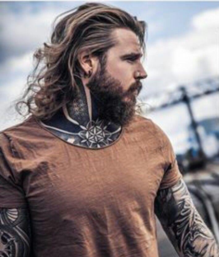 Long hair and a beard.