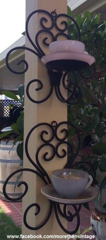 Teacup Candles on wrought iron under the pergola, beautifully made by Diane