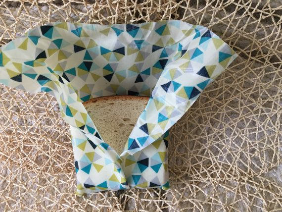 Reusable and washable beeswax wrap with a fun Lots of Triangles design. Great eco-friendly substitute for plastic wrap! Use to wrap and store bread,
