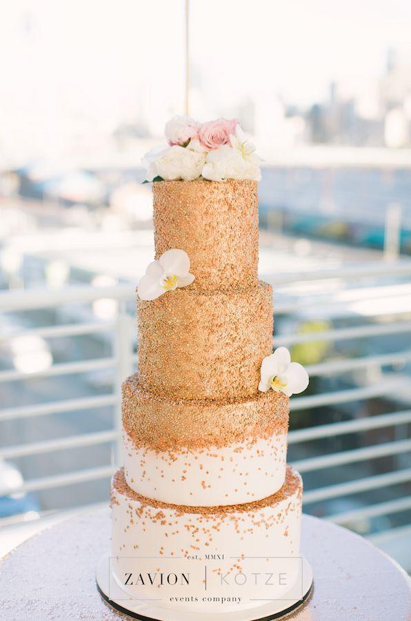 What a stunning wedding cake. White and rose gold cake, 4 tier cake, floral cake, gold cake. expensive wedding cake, designer cake