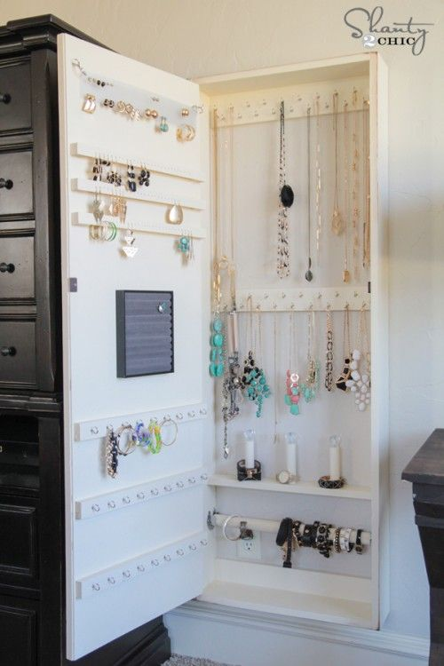 DIY Jewelry Storage Mirror! The tutorial looks very complicated, but when I have the patience, money, and time, I would love to do this. :)