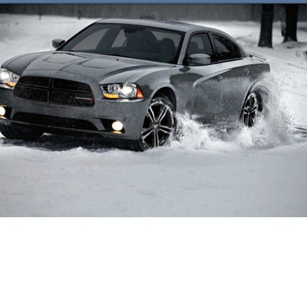Dodge Charger just plowing through the snow.