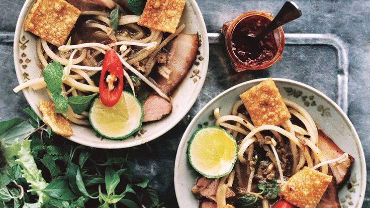 Fresh and long-cooked textures; rich, sweet, and herbal flavors; and juicy and crunchy garnishes make this Vietnamese noodle dish delicious.
