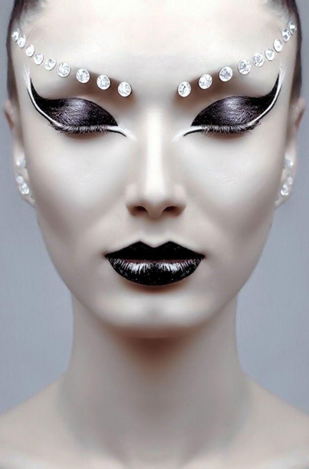 this is a more modern look on the make up i was thinking but i love the simetrimy and the gems to create a fake eyebrow i may have to try this or contemplate another style like this as it would give the modern twist i wanted