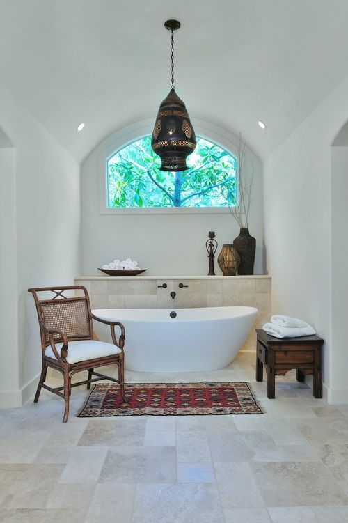 Bathroom design trend #2:Go for a free-standing tub or build out your tub surround away from the wall. A tub placed on a beautifully tiled floor can bring a more luxurious feel and add some sculpture and style in your bathroom. It also makes your bathroom feel larger and that's always a good thing!