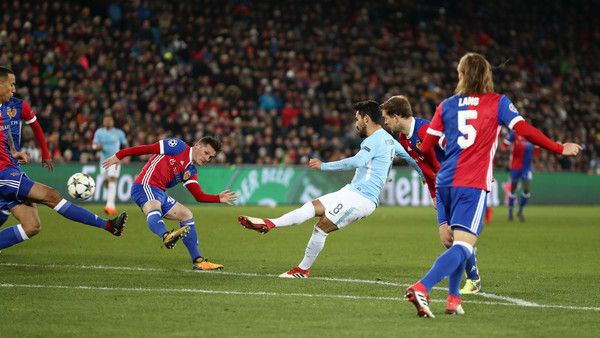 Ilkay Gundogan Photos - Ilkay Gundogan of Manchester City scores his sides fourth goal during the UEFA Champions League Round of 16 First Leg  match between FC Basel and Manchester City at St. Jakob-Park on February 13, 2018 in Basel, Switzerland. - FC Basel v Manchester City - UEFA Champions League Round of 16: First Leg