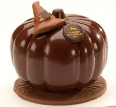 This solid dark chocolate pumpkin from La Maison Du Chocolat holds confections for a sweet Halloween party.