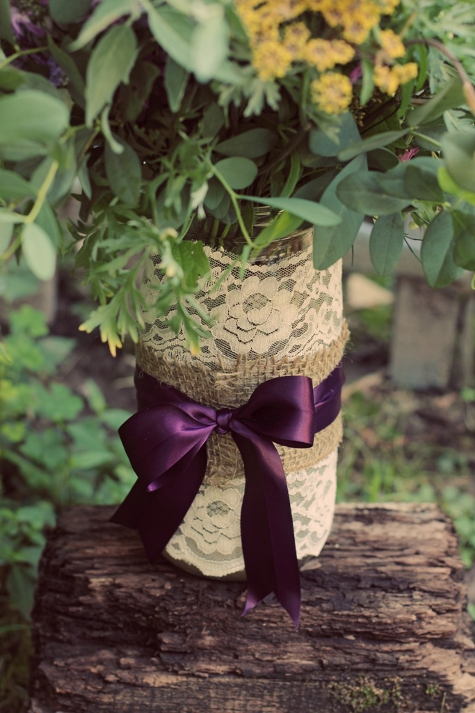 Jars wrapped in lace, burlap and ribbon