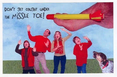 Hilarious holiday card ideas: caught under the missle toe. (Photographer unknown)