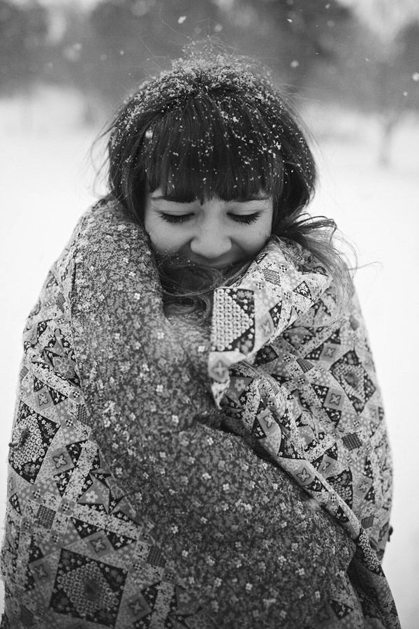 Pictures in the snow with a colorful blanket. ......and then make the photo black and white, because I love the look of black and white winter photos!
