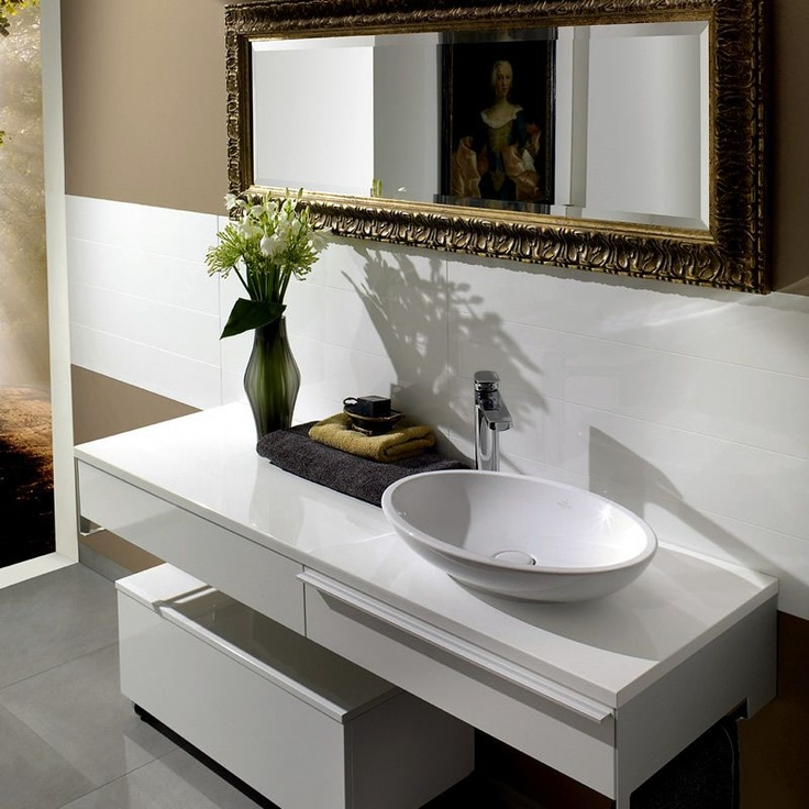 Nice contrast of the traditional gold framed mirror and contemporary bathroom fittings. Villeroy & Boch Bianco Nero Tile 1895 (15 x 60cm). Buy Ceramic Wall & Floor Tiles from UK Bathrooms