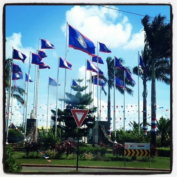 """#Belize Flags raised in celebration of Independence 21st September """"Many Faces, Many Dreams, One Goal - Celebrating Belize 31 years"""""""