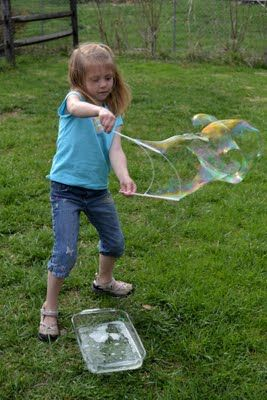 Make your own really big bubble maker. Straws and string.