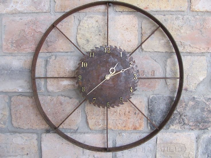 I finished this last night. An old plow wheel & saw blade.  Another piece for our rustic outdoor kitchen!!