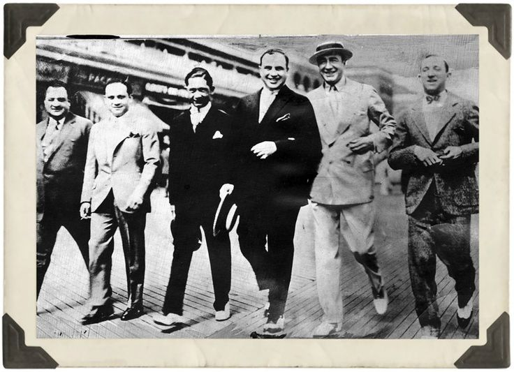 "Meyer Lansky, Al Capone, Enoch ""Nucky"" Johnson and friends walking the boards, Atlantic City. April, 1929"