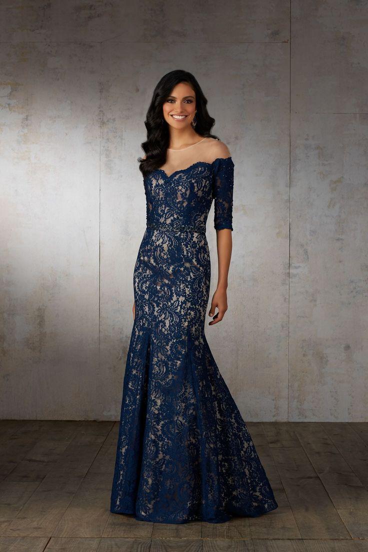 Dopasowana, koronkowa suknia dla Mam, idealna na sylwestra. Elegancka suknia z koronkowym rękawem 3/4. Iluzja opadającego rękawa, dzięki iluzorycznemu materiałowi …