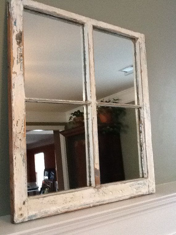 This window pane was taken from a home in Ann Arbor, Michigan. Paint is natural but has been newly distressed and sealed. 29 1/2 x 32 bistable are areas of blur and natural wood. See close-up picture. Mirror is new. Finished paperback and hang wire have been installed.