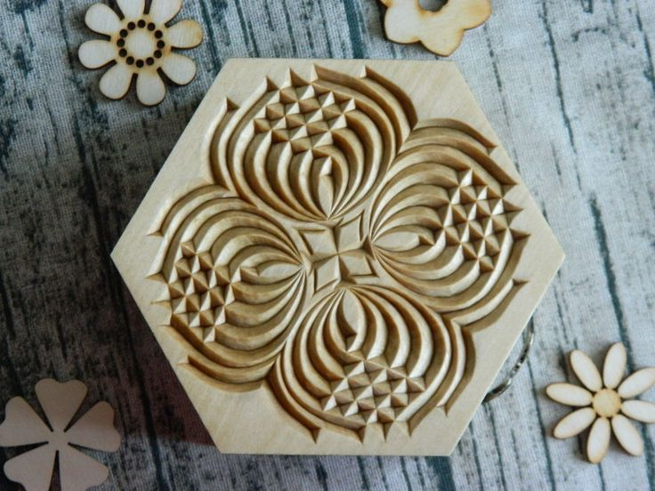 Hi everyone, I'm Tatiana. I am a professional woodcarving artist with a degree in Applied Fine Arts from the Volga Regional State University in Russia. I specialize in chip carving on basswood and draw my inspiration from my own life, nature, and music.
