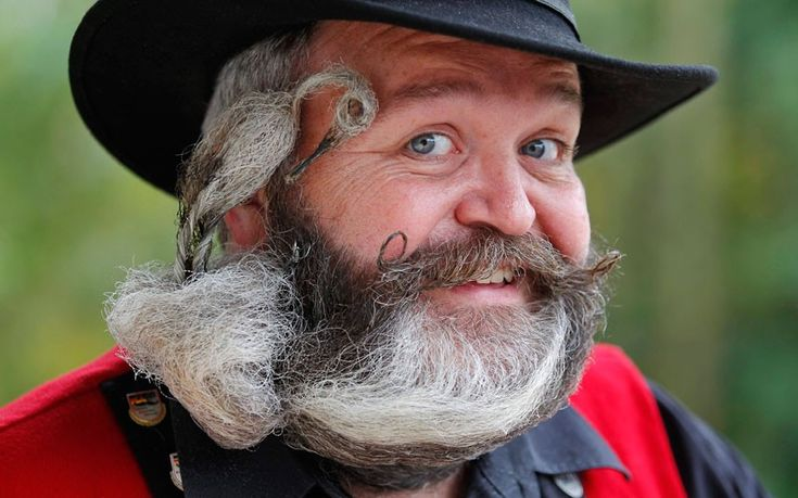 German hairdresser Elmar Weisser, 48, shows off his beard, which is shaped like a stork, during the 2012 European Beard and Moustache Championships in Wittersdorf near Mulhouse, Eastern France. Weisser, who won the World Beard and Moustache Championship in 2011, ranked second in the freestyle category this year.