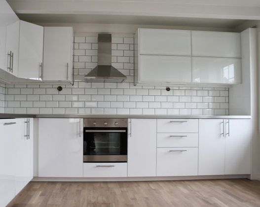 IKEA Ringhult Kitchen In Gloss White.