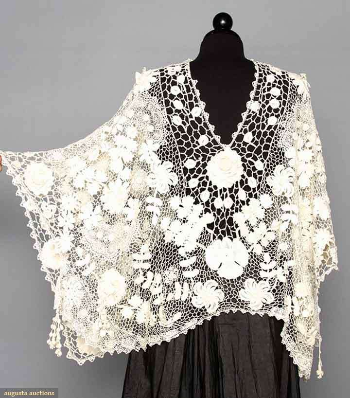 "IRISH CROCHET SHAPED SHAWL, c. 1910 Shamrock, flower & foliage patterned lace, falls below hip in front & to waist in back, CF L 19"", CB L 23.5"","