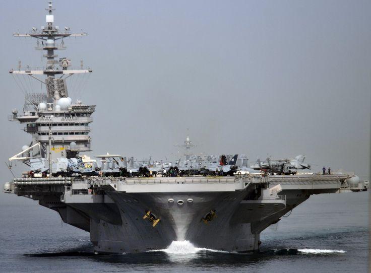 The Nimitz-class aircraft carrier USS Carl Vinson (CVN-70) transits the Strait of Hormuz.