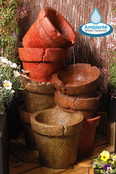 This attractive water feature, featuring 8 cracked plant pots piled together in three tiers, has been wonderfully crafted out of high quality polyresin to create this lovely water feature. Enjoy relaxing to the sound of water gently cascading down three of the eight rustic-lo