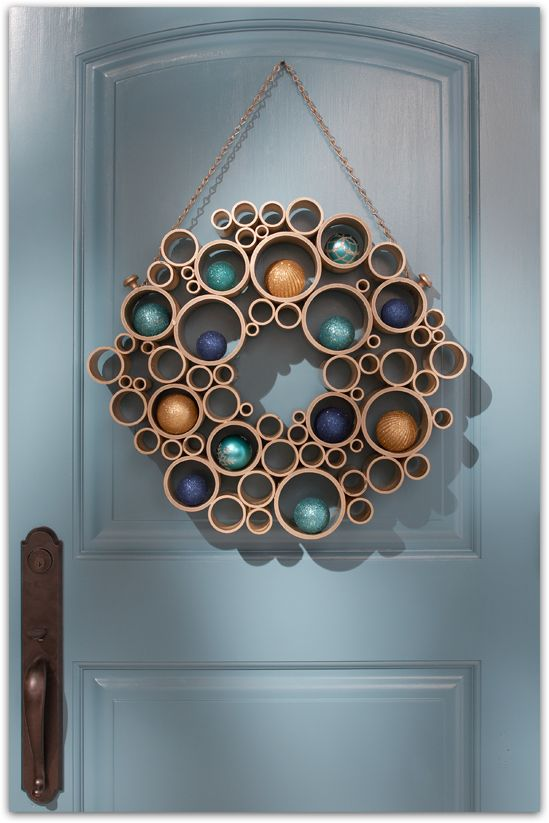 Very modern take on a holiday wreath, made from cut PVC pipes.