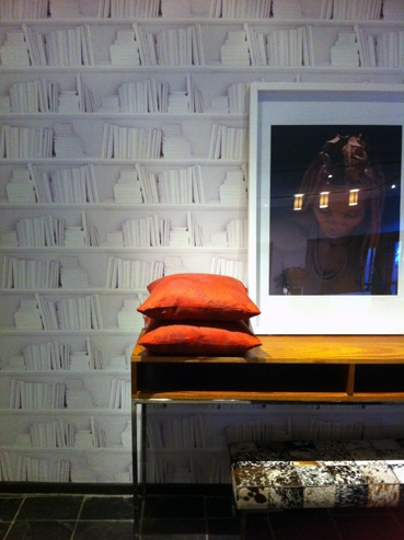 Bookshelf wallpaper by Mineheart - tres cute! Available at Klooftique on Kloof street, Cape Town