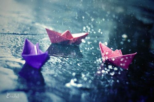 Paper boats in the rain.