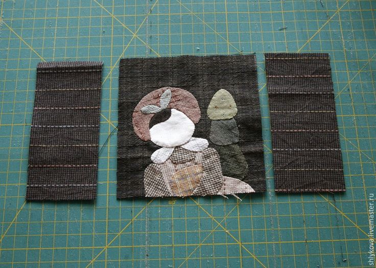 Вам понадобятся инструменты и материалы: ножницы; иглы для аппликаций; нитки желательно 100% хлопок; бумага для заморозки; японский фактурный хлопок; клей для текстиля; микропуговки; краски для текстиля; ткань для пэчворка, США, светлых оттенков с размытостями; иглы для квилтинга; рамка для саквояжика из двух деталей размер 4*10 см; японская молния 23 см.