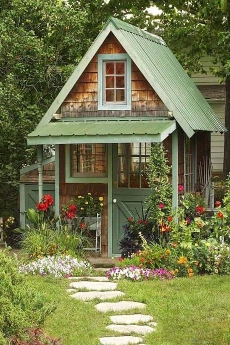 Love Grows Best In Little Houses Doug Stone This Garden Shed Reminds Us Of A Quaint Cottage For One Perfect Cottage Garden Sheds Shed Cottage Garden